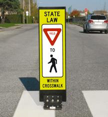 In-street pedestrian R1-6 sign