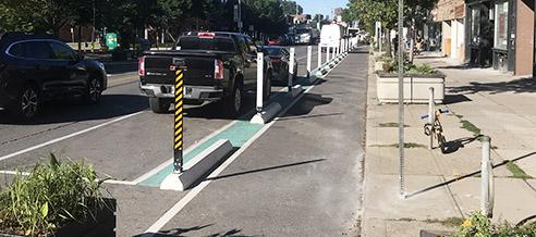 Bike lane with flexible bollard on pre-cast concrete curbs